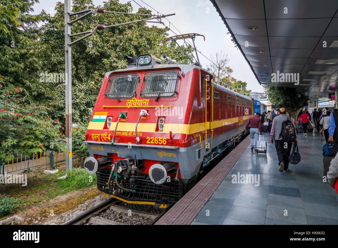Red train engine at the platform in Kalka Station, Kalka, Haryana, northern India, terminus of the Delhi to Kalka Stock Photo