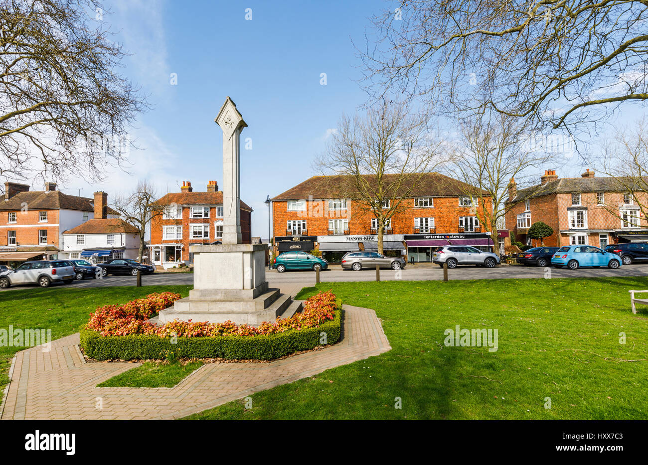 Traditional war memorial, High Street, Tenderden, Kent, south-east England, UK on a sunny spring day with blue sky - Stock Image
