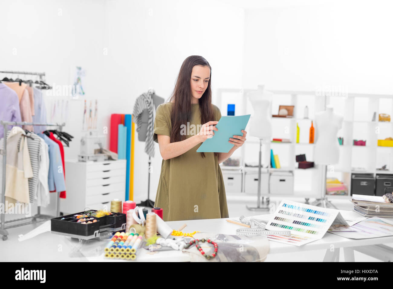 Young Fashion Designer In Her Workshop Looking Confident At The Stock Photo Alamy