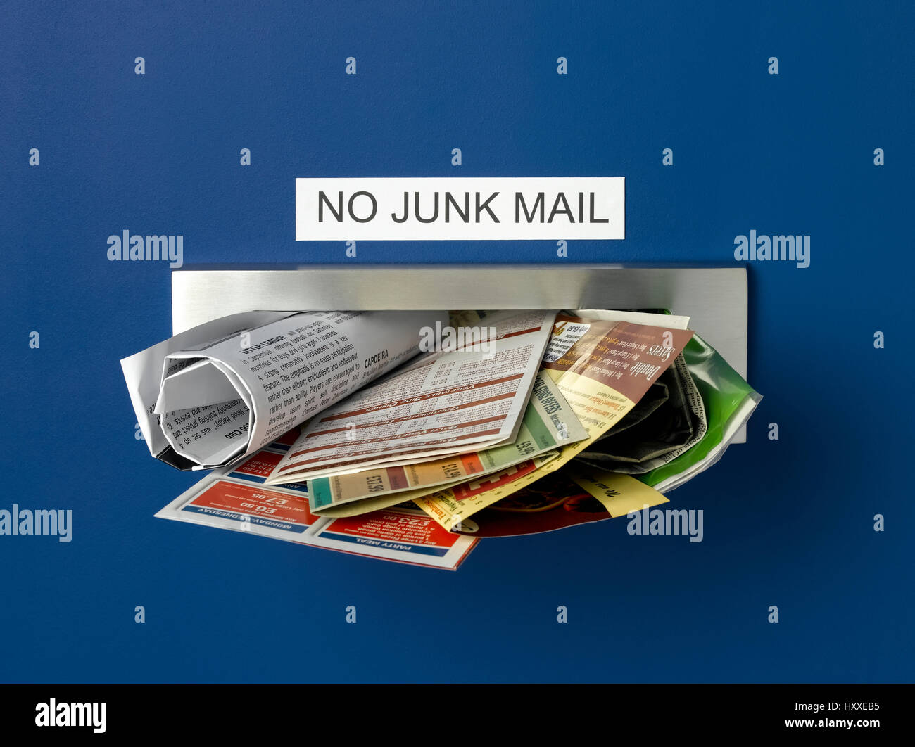 Postbox overflowing with junk maill - Stock Image