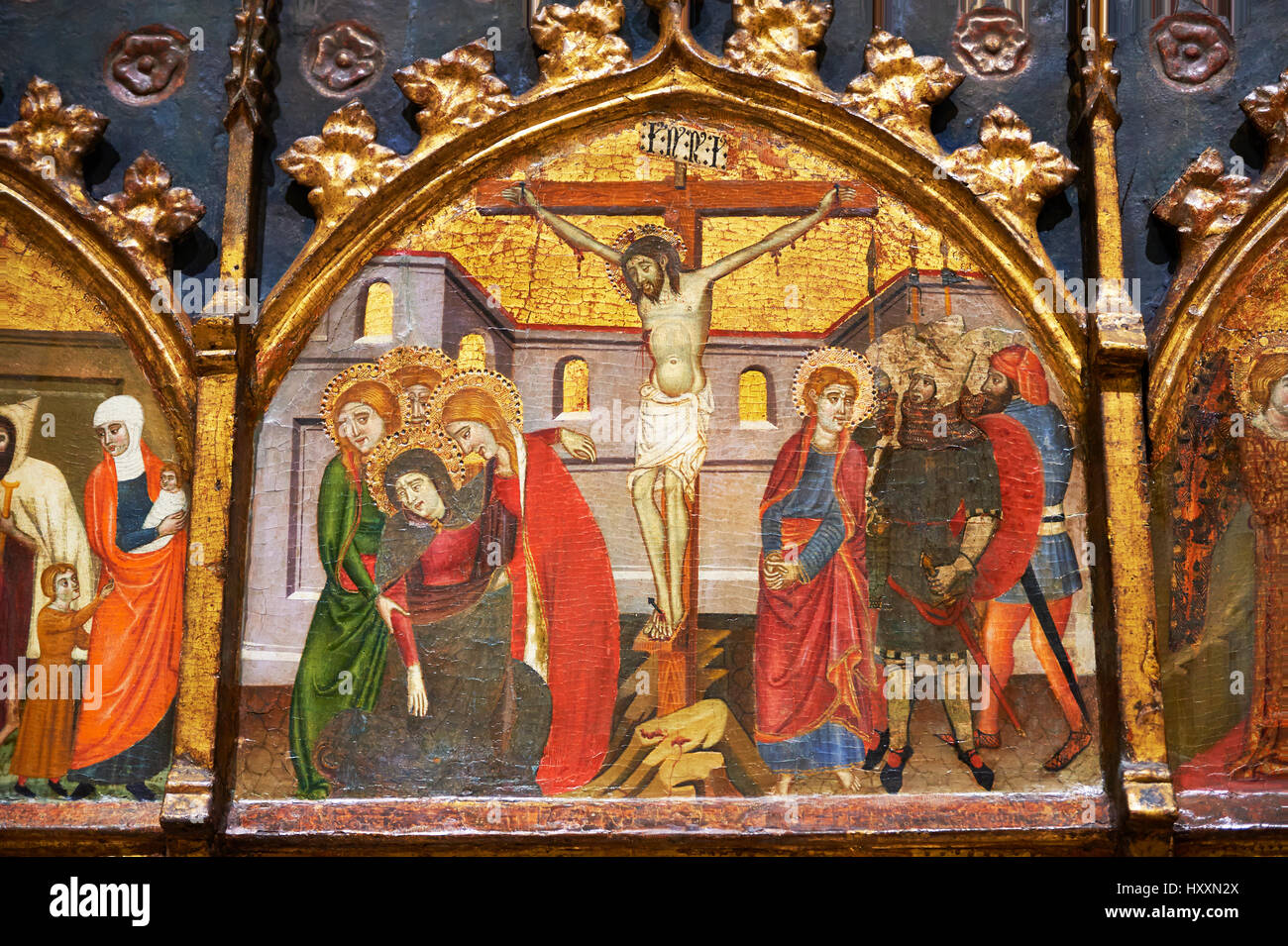 Gothic painted Panel Altarpiece of Saint Stephen by  Jaume Serra. Tempera, gold leaf and metal plate on wood. Circa - Stock Image