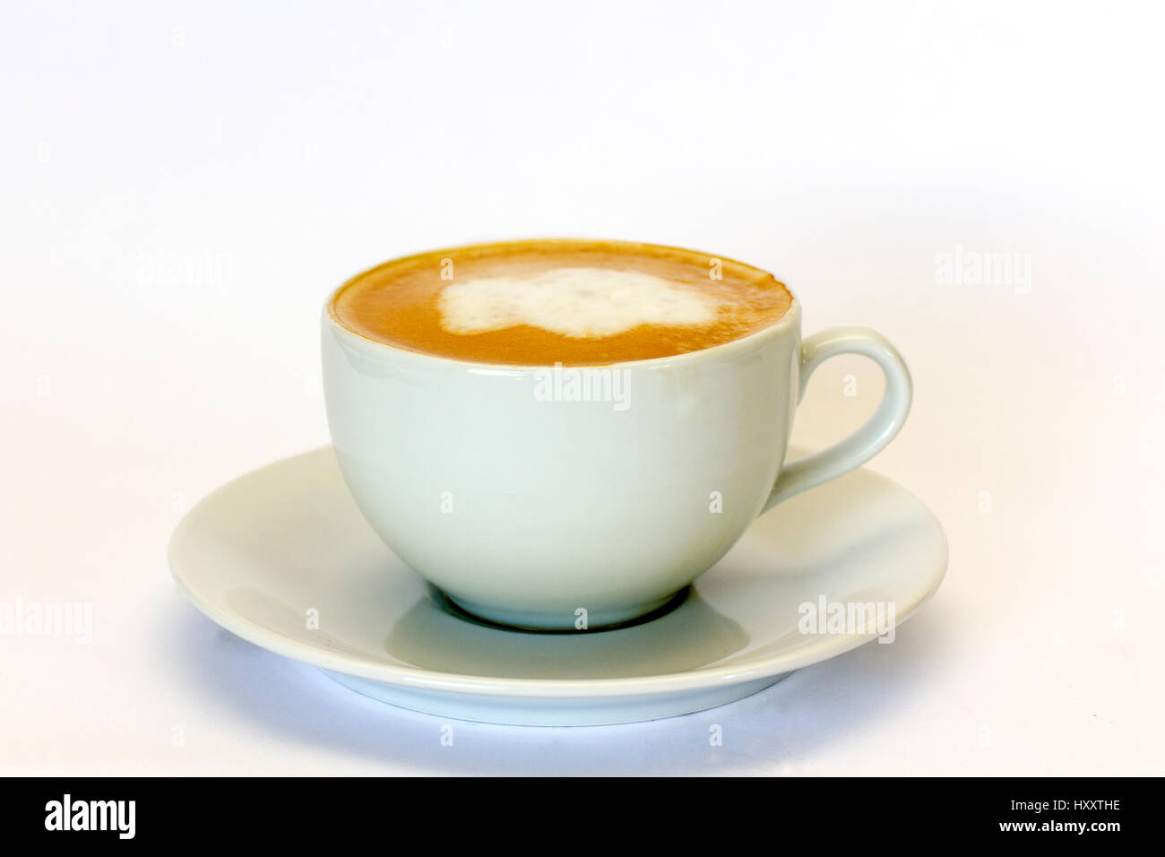 Cappuccino in a cup and saucer - Stock Image