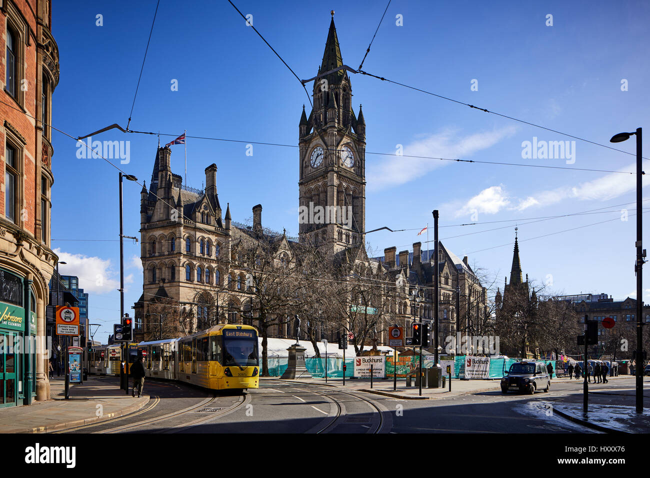 Metrolink second crossing passes Manchester City Council Town Hall in Albert Square  Manchester, England, UK.   - Stock Image