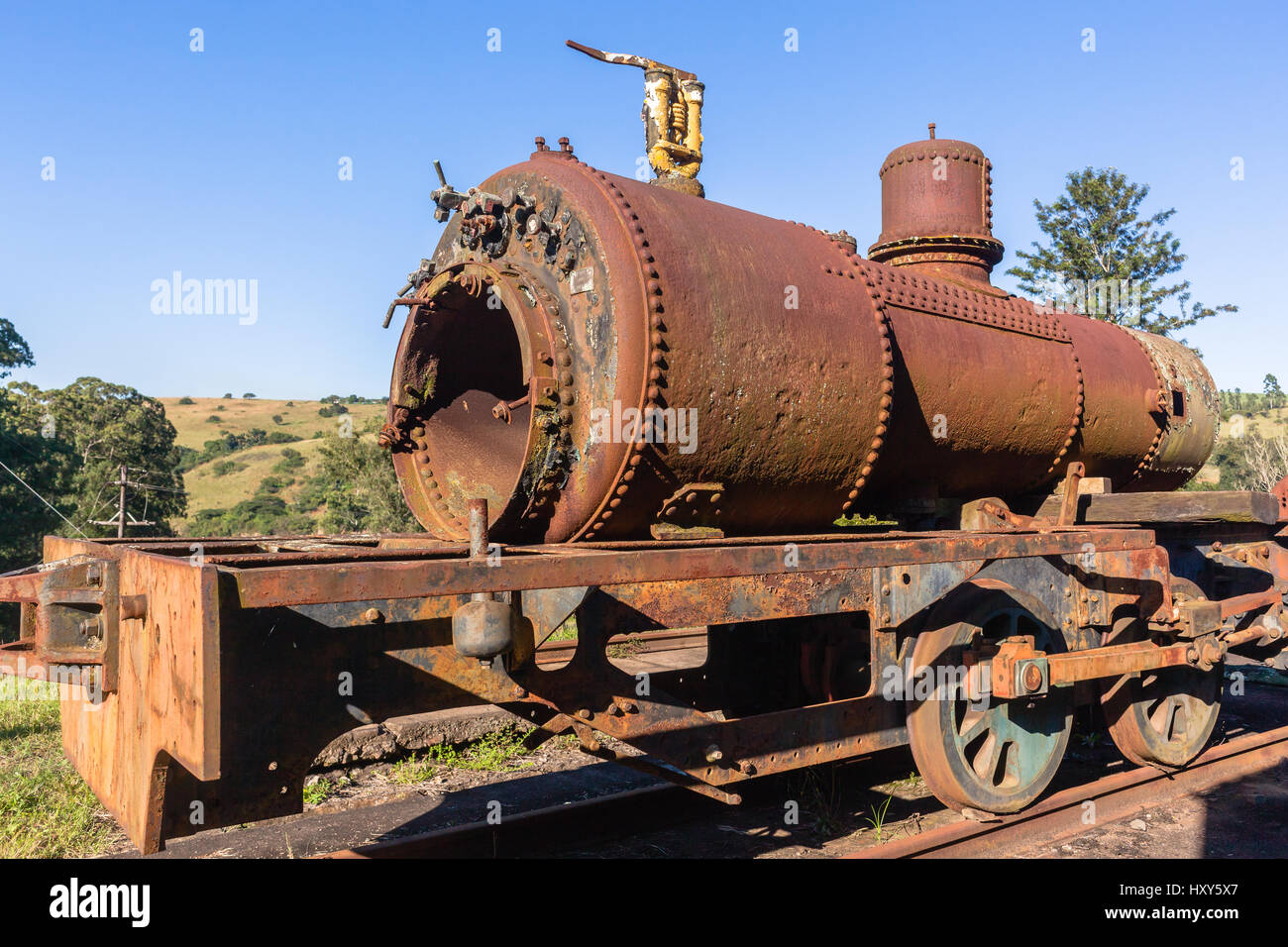 Steam Train old steam locomotives boiler stamped 1951 decaying station graveyard. Stock Photo