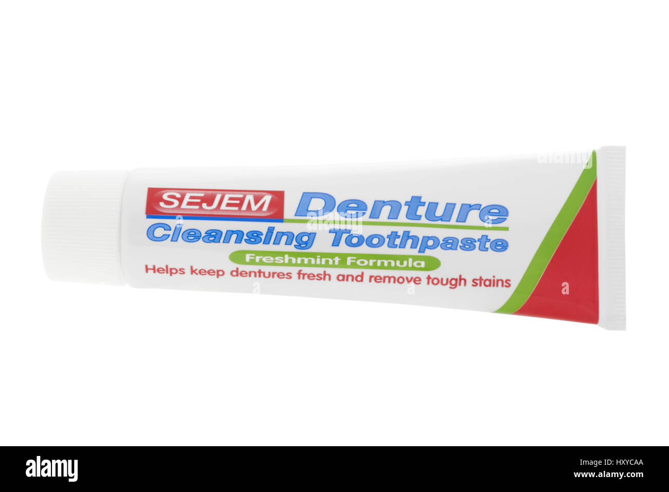 Tube of denture cleansing toothpaste on white background - Stock Image