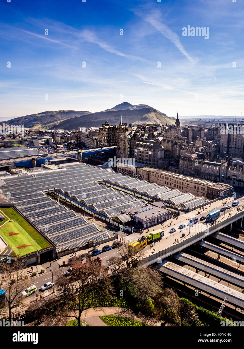 Edinburgh Waverley Station exterior showing Waverley Bridge at west of station and extensive glass roof covering - Stock Image