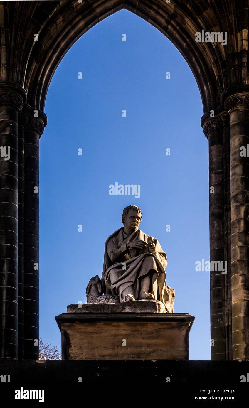 Statue of Sir William Scott beneath the Scott Monument in Princes Street Gardens East, Edinburgh. Stock Photo