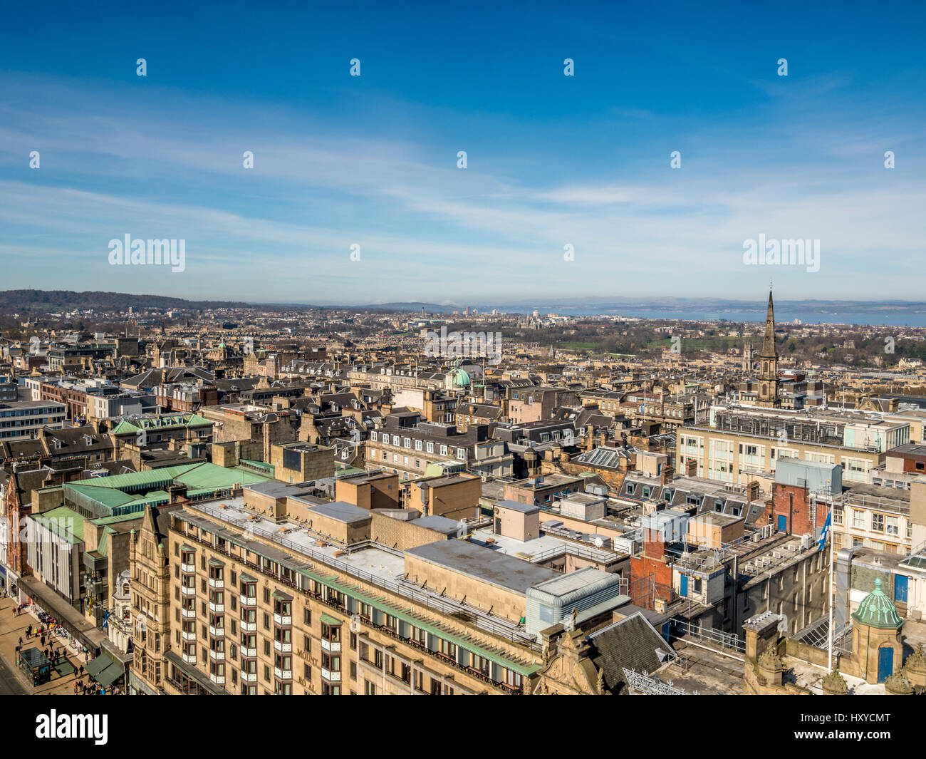 View across Edinburgh rooftops towards The Firth of Forth, Scotland. Stock Photo