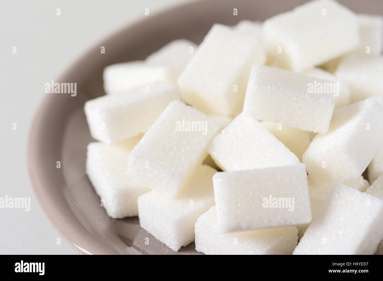 Closeup of a pile of cubes of white refined sugar - Stock Image