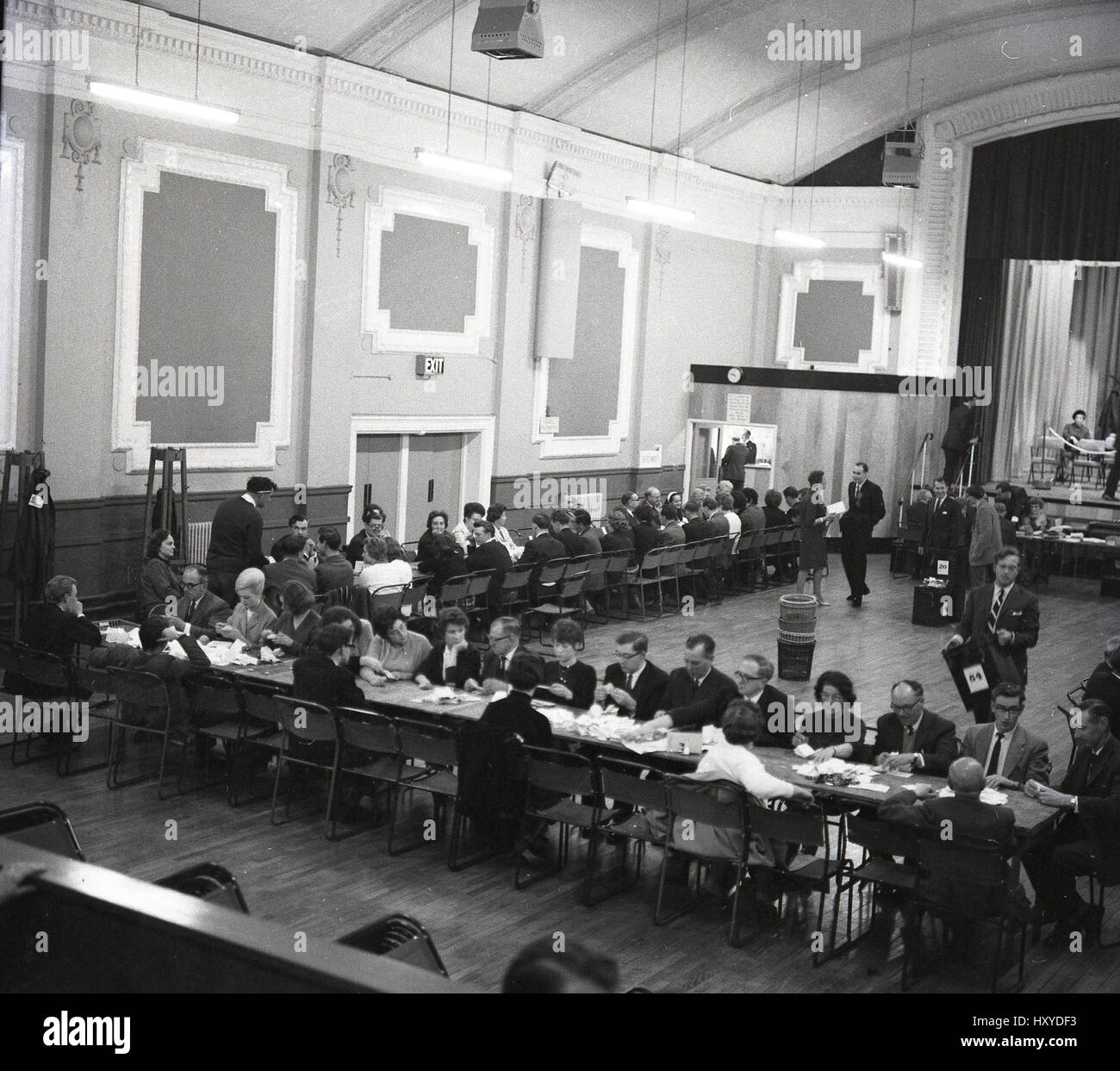 1960s, historical, men and women counting votes at a a counting centre for a British Parliamentary election, Aylesbury, - Stock Image