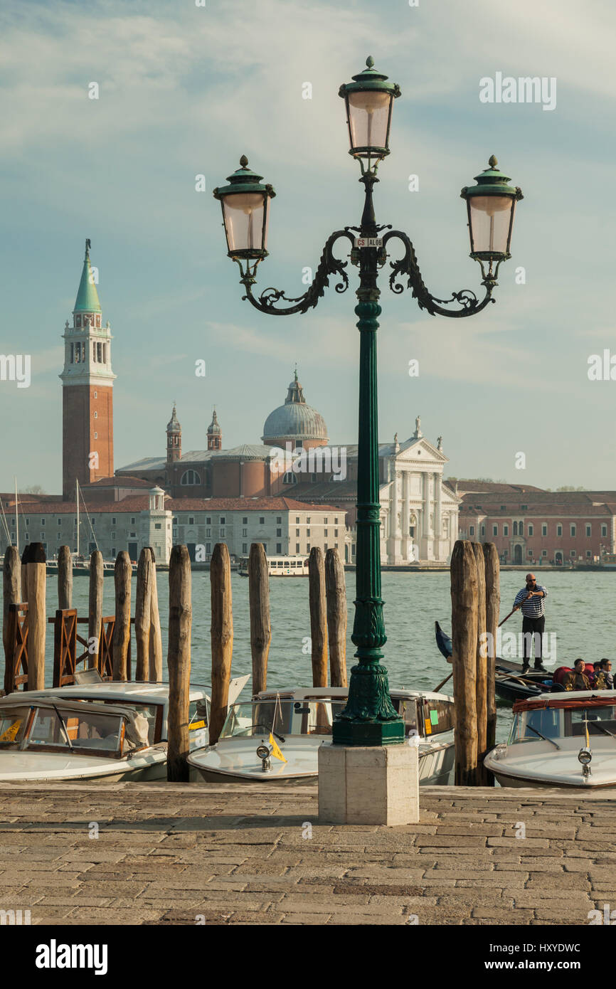 Spring afternoon in sestiere of San Marco, Venice, Italy. San Giorgio Maggiore church in the distance. - Stock Image