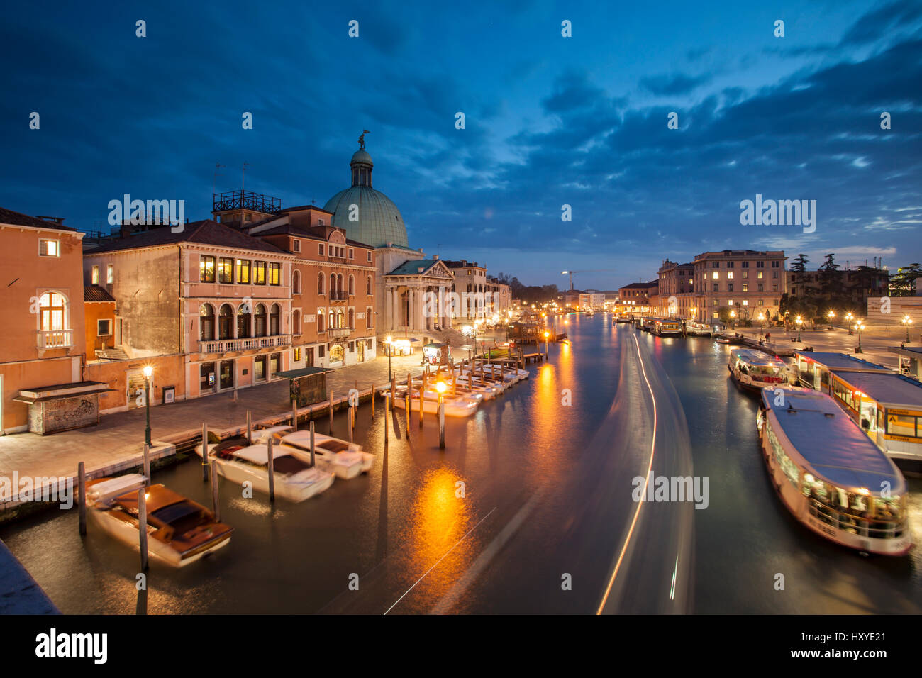 Night falls on Grand Canal in Venice, Italy. - Stock Image