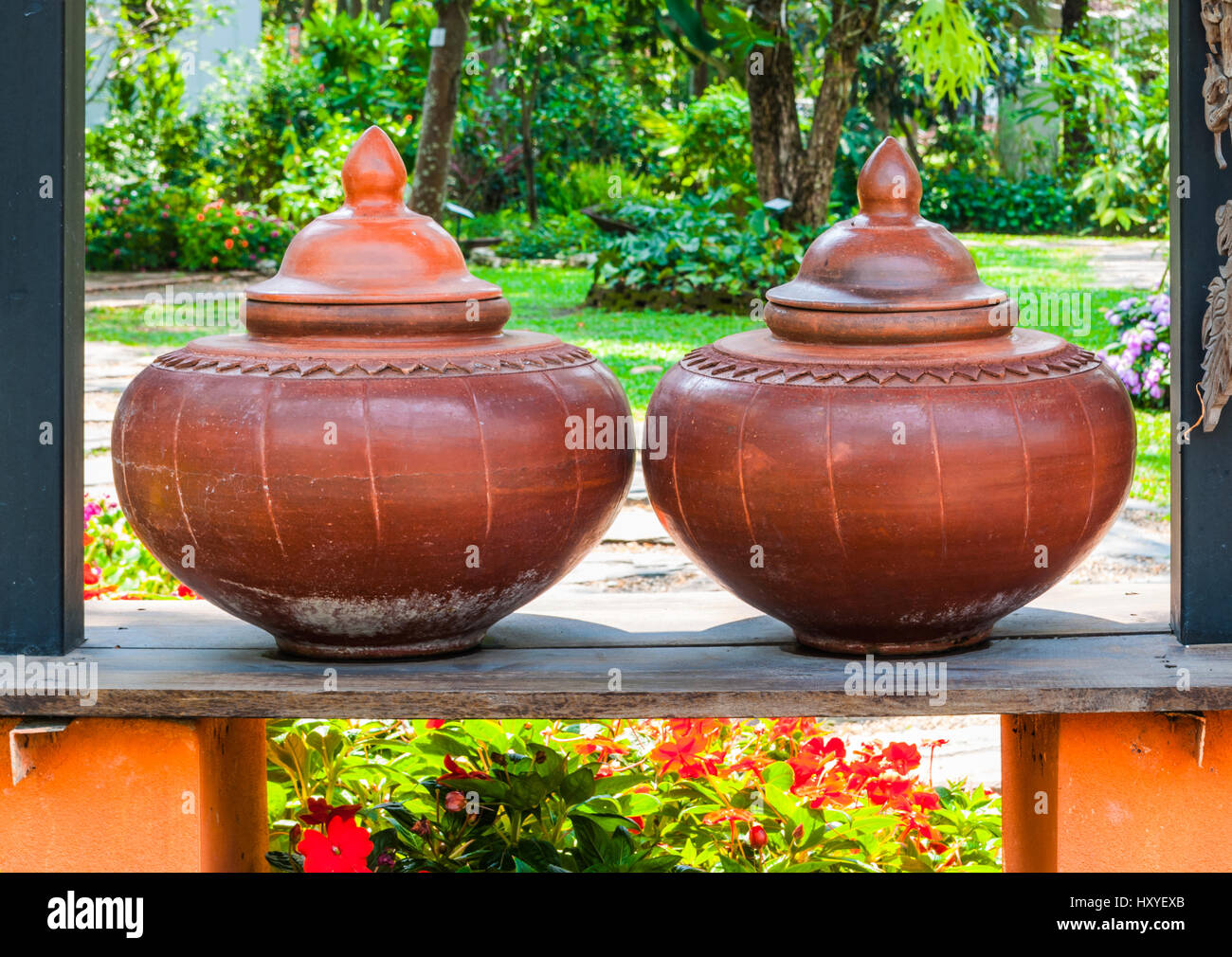 Closeup to Couple of Brown Baked Clay Flagon in Ancient Tradition Northern Thai Style Stock Photo