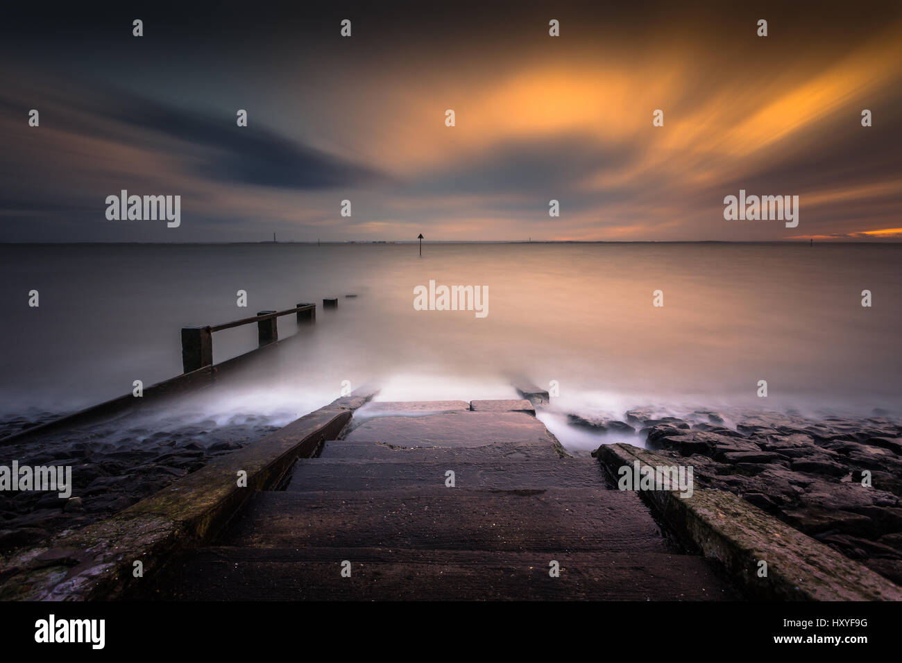 long exposure seascape with steps into the sea Stock Photo