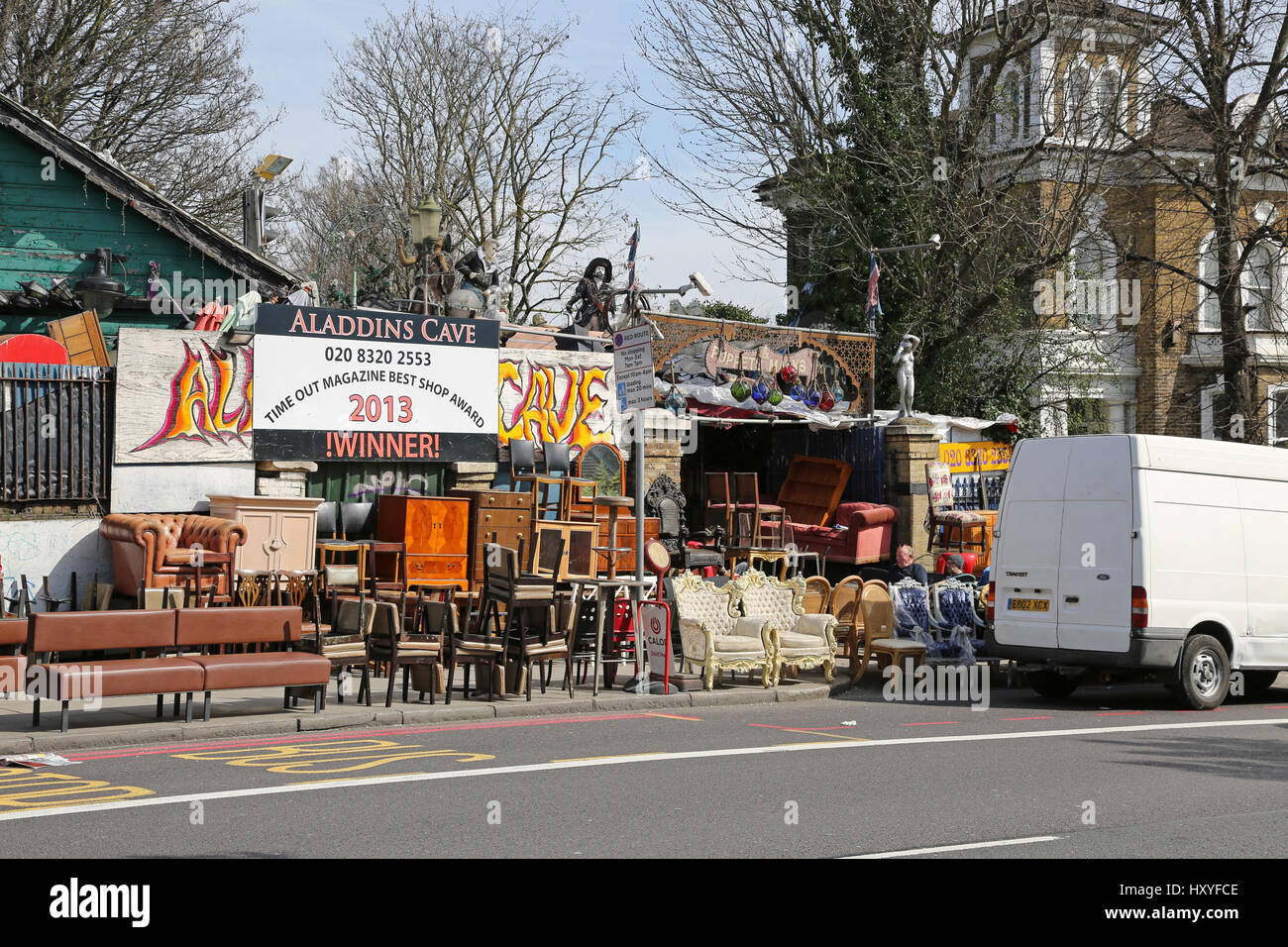 Aladin's Cave, a second-hand furniture store in Lewisham, southeast London. Famous for packing the pavement - Stock Image