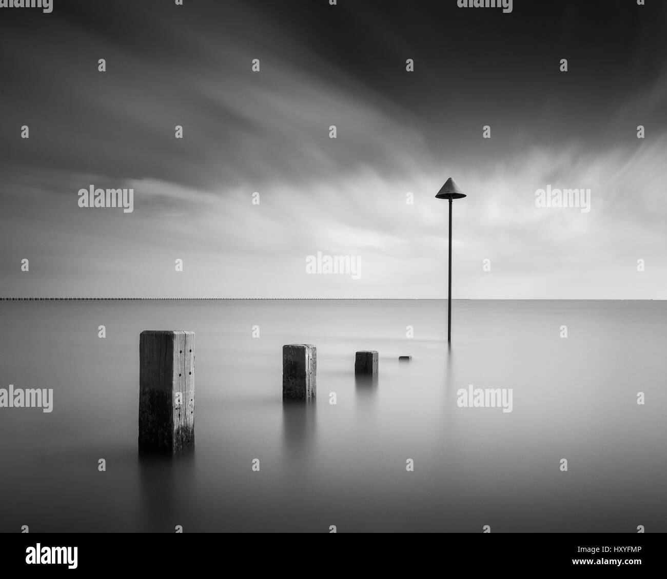 Groynes and marker in long exposure fine art - Stock Image