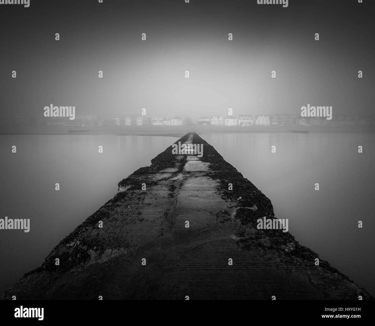 foggy seascape looking back towards land or shoreline, Southend on sea, essex Stock Photo