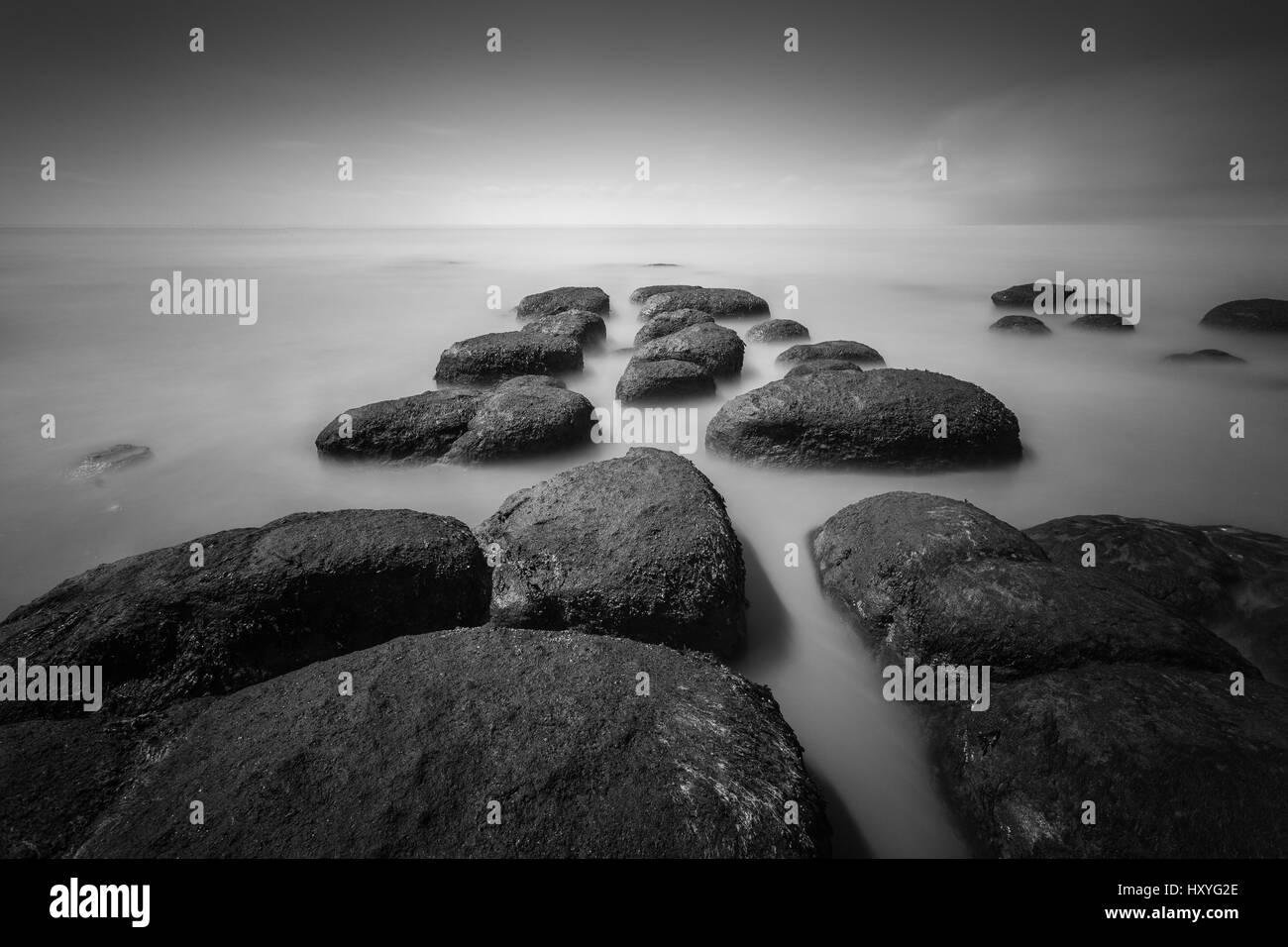 Hunstanton Boulders in Sea, Long exposure, Norfolk Stock Photo