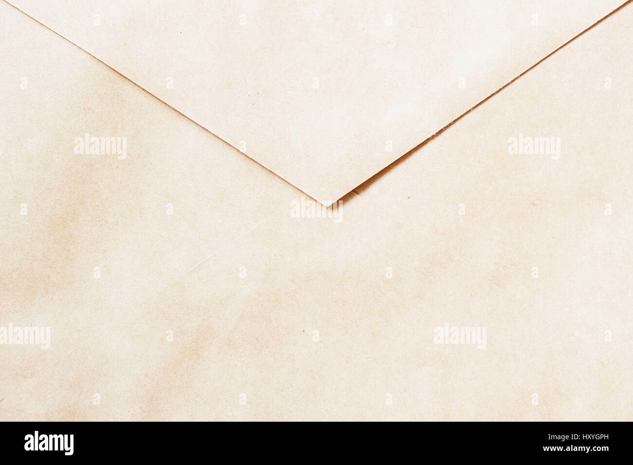 Texture of Vintage paper envelope, back side. Top view. Background , backdrop, substrate, composition use for design. - Stock Image