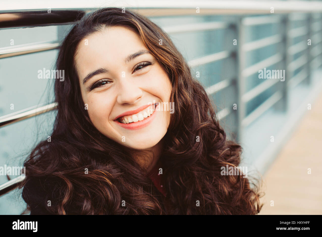cute brunette woman laughing in the street stock photo: 137060099