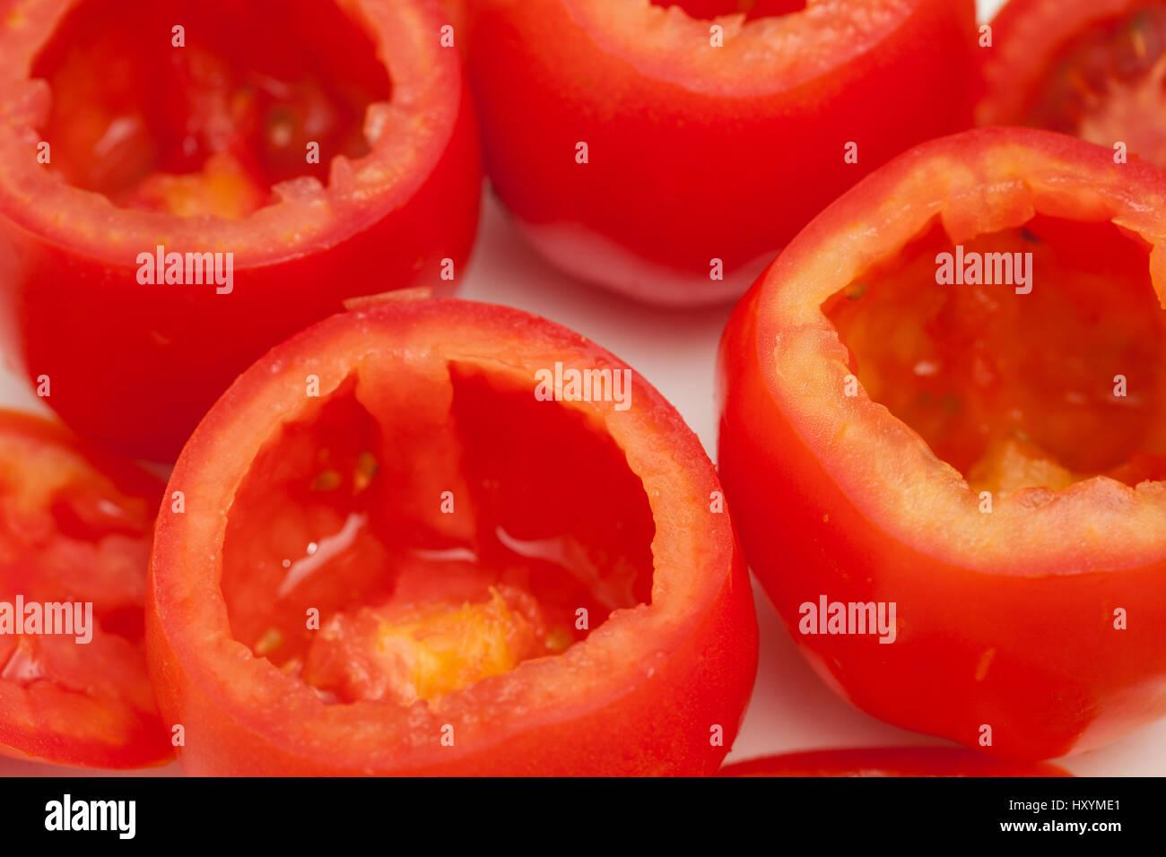 Stuffed tomatoes preparation : Emptied tomatoes Stock Photo