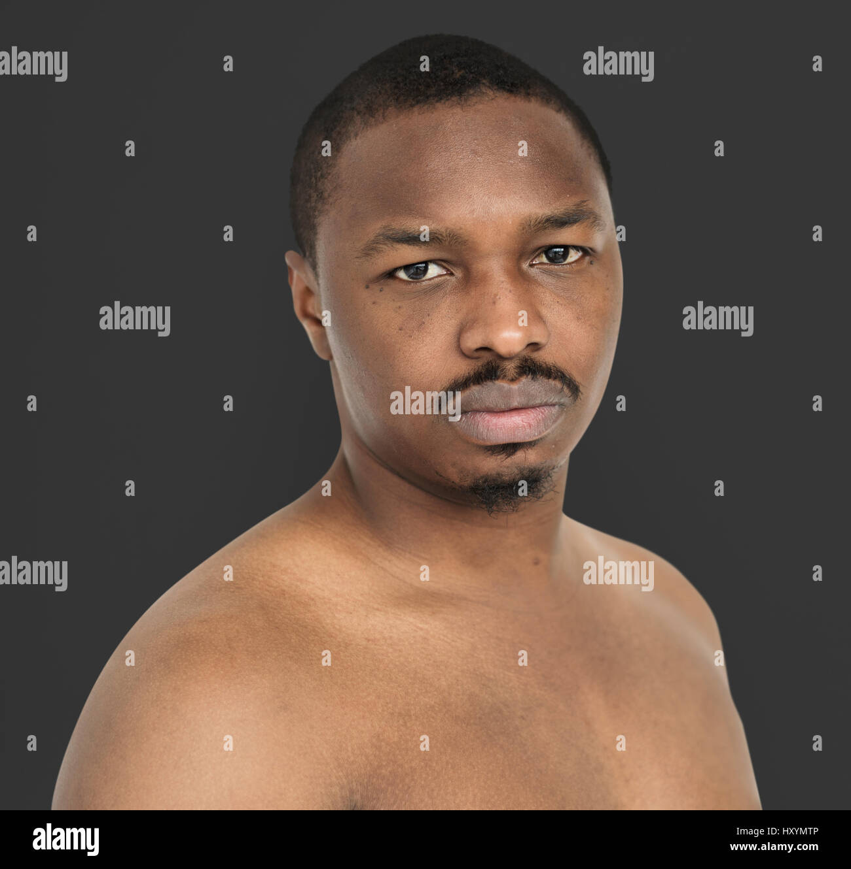 African Descent Man Barechested Studio - Stock Image
