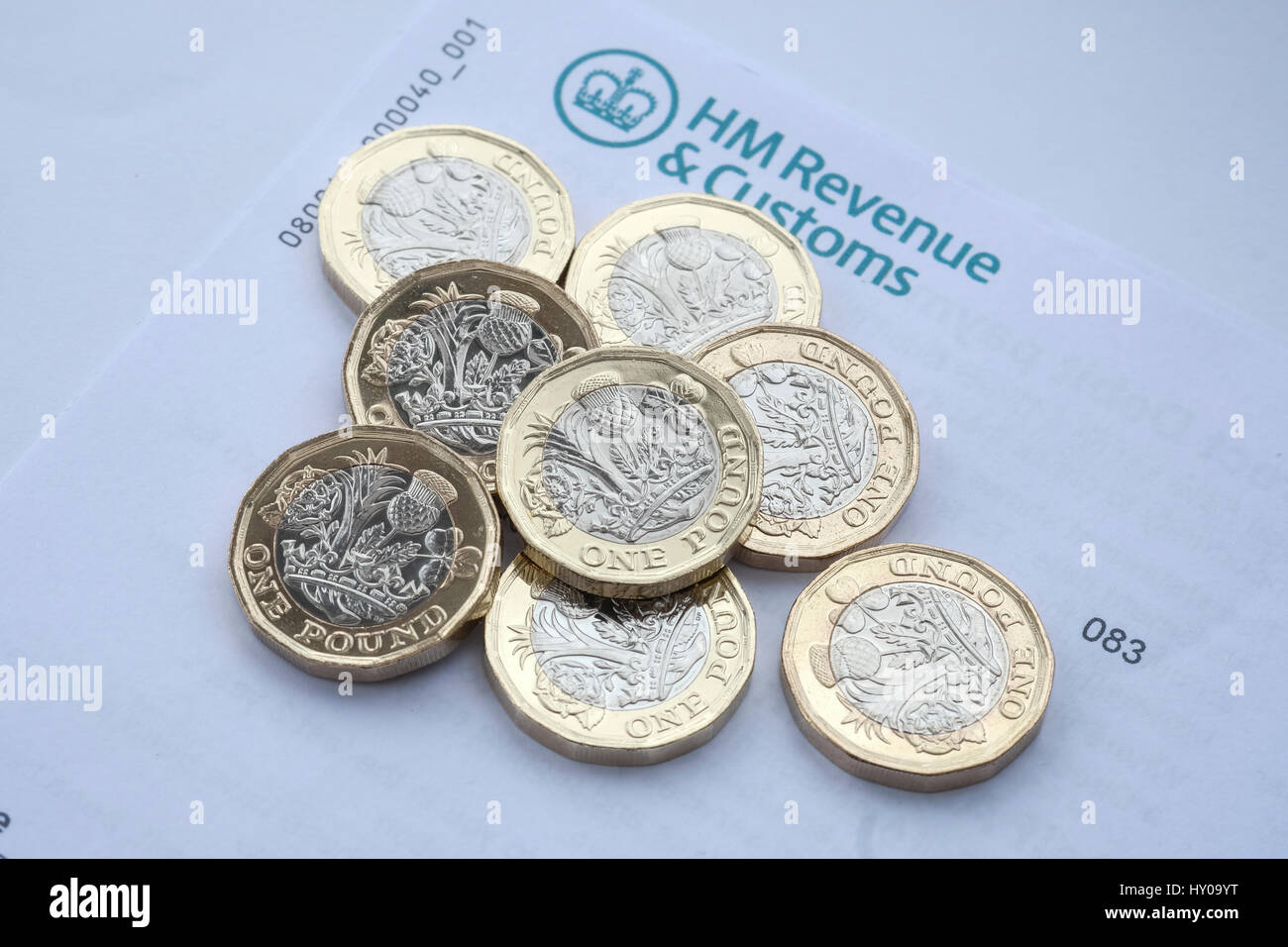 Tax letter with new pound coins - Stock Image