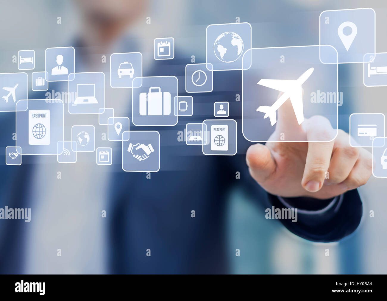 Business trip concept with a businessman touching a button on a screen with icons about travel planning, transportation, - Stock Image