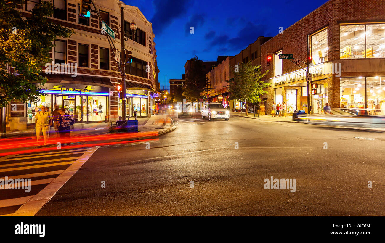 Pedestrians and traffic on a busy city street in downtown Asheville, North Carolina, timelapse - Stock Image