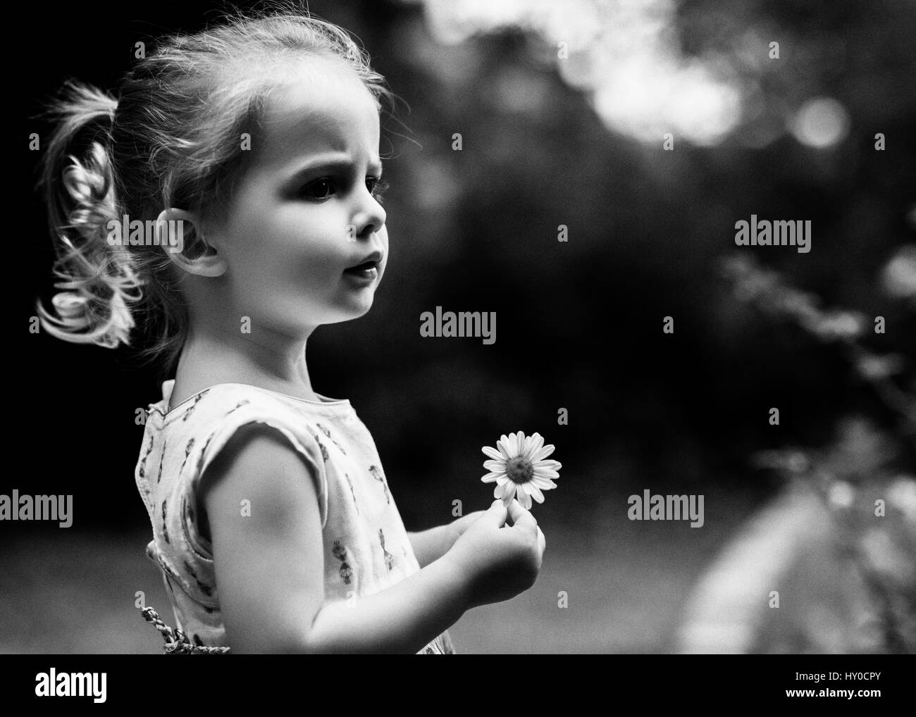 Girl Holding Flowers Black And White Stock Photos Images Alamy