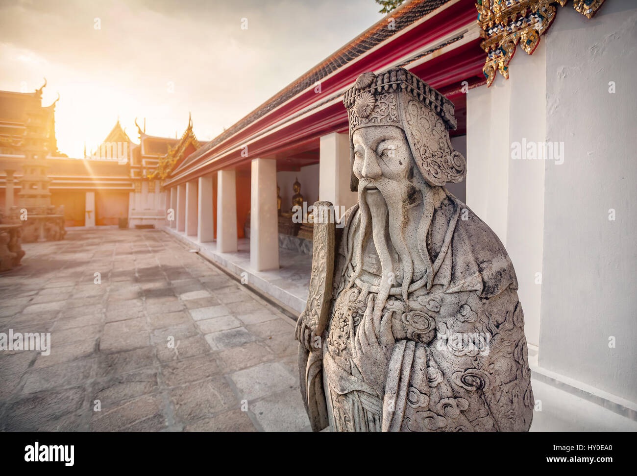 Stone statue of monk in Buddhist Temple Wat Pho in Bangkok, Thailand - Stock Image