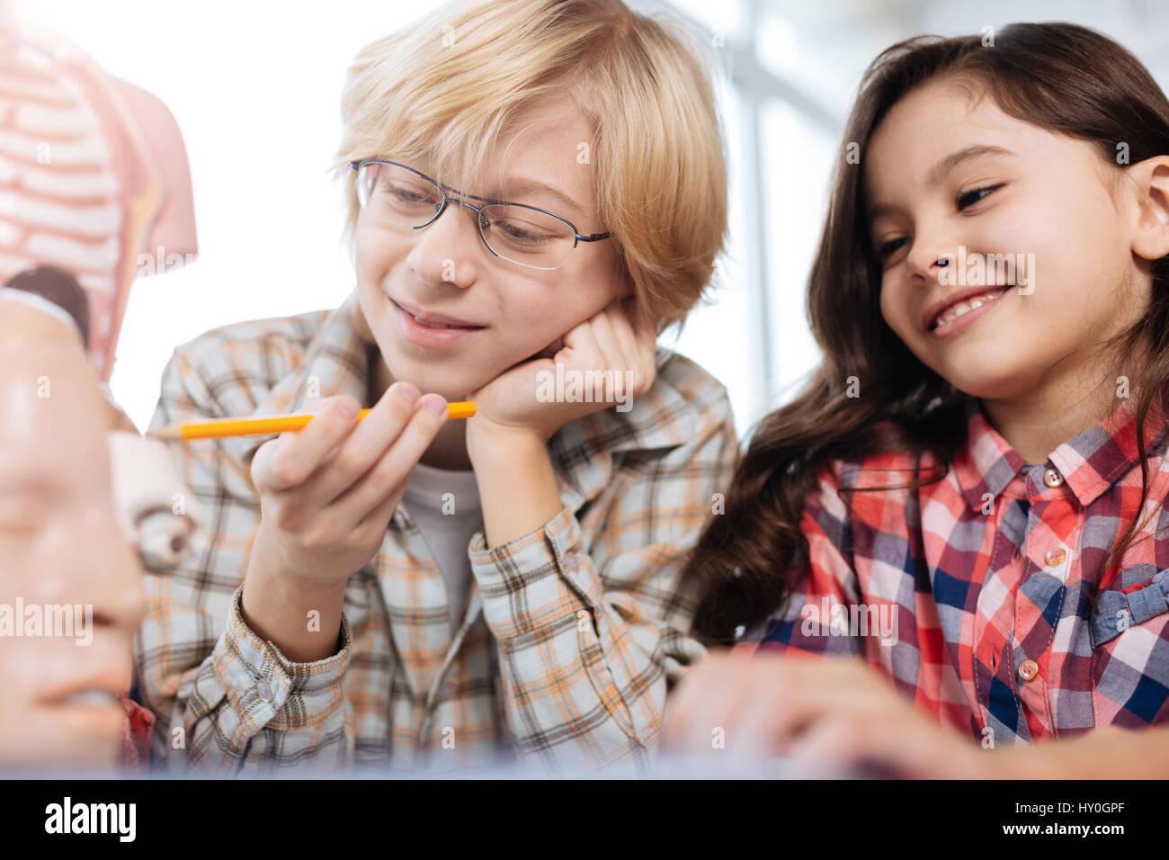 Enthusiastic children studying human anatomy - Stock Image