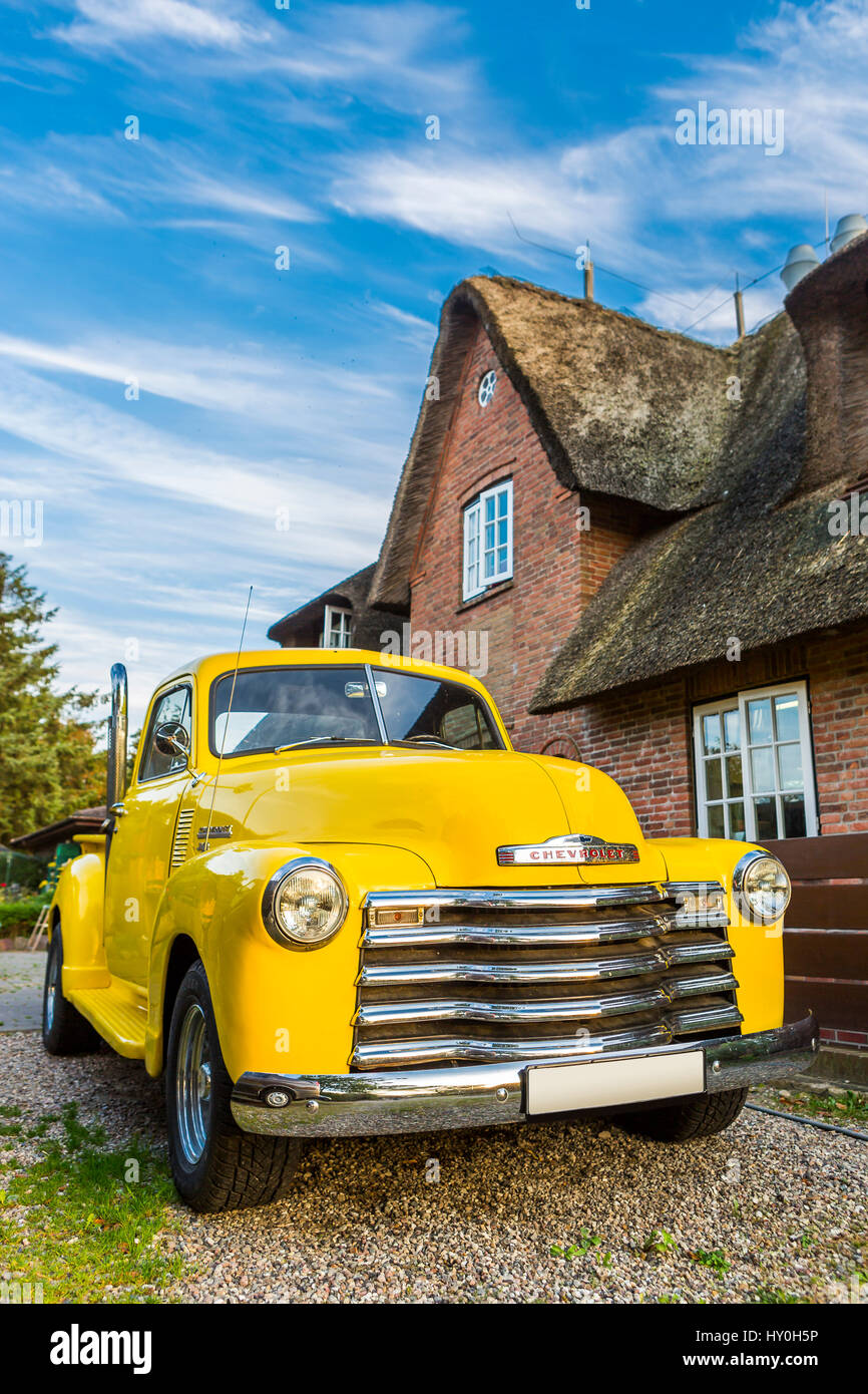 Chevrolet Oldtimer Pickup in front of a frisian house, Sylt, Germany Stock Photo