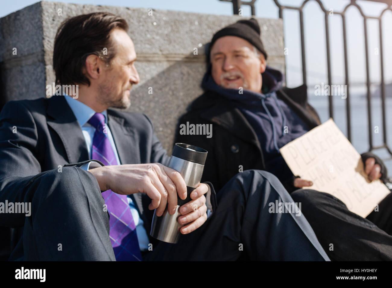 Delighted men having nice conversation Stock Photo