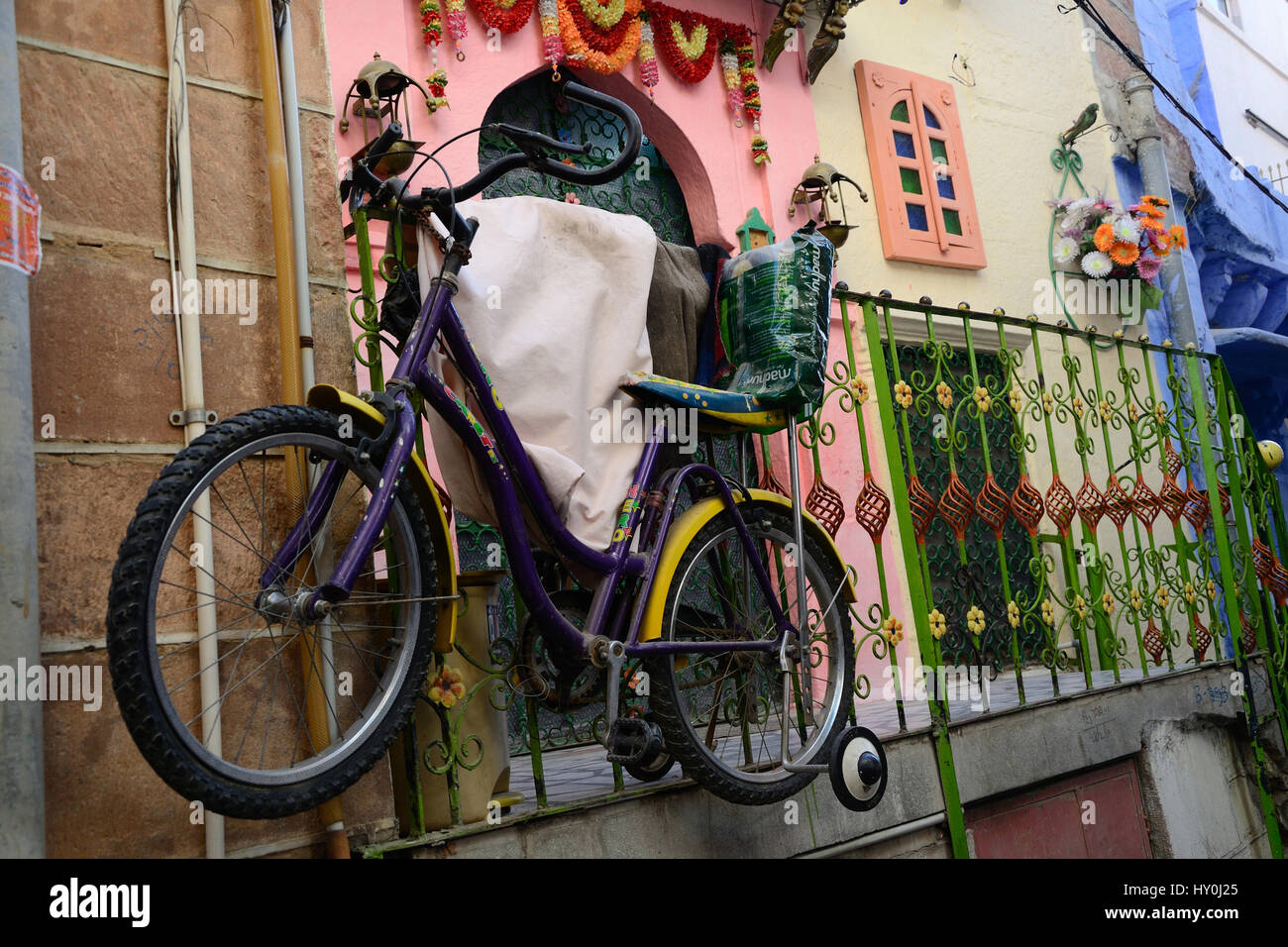 Bicycle tied with iron grill, jodhpur, rajasthan, india, asia - Stock Image
