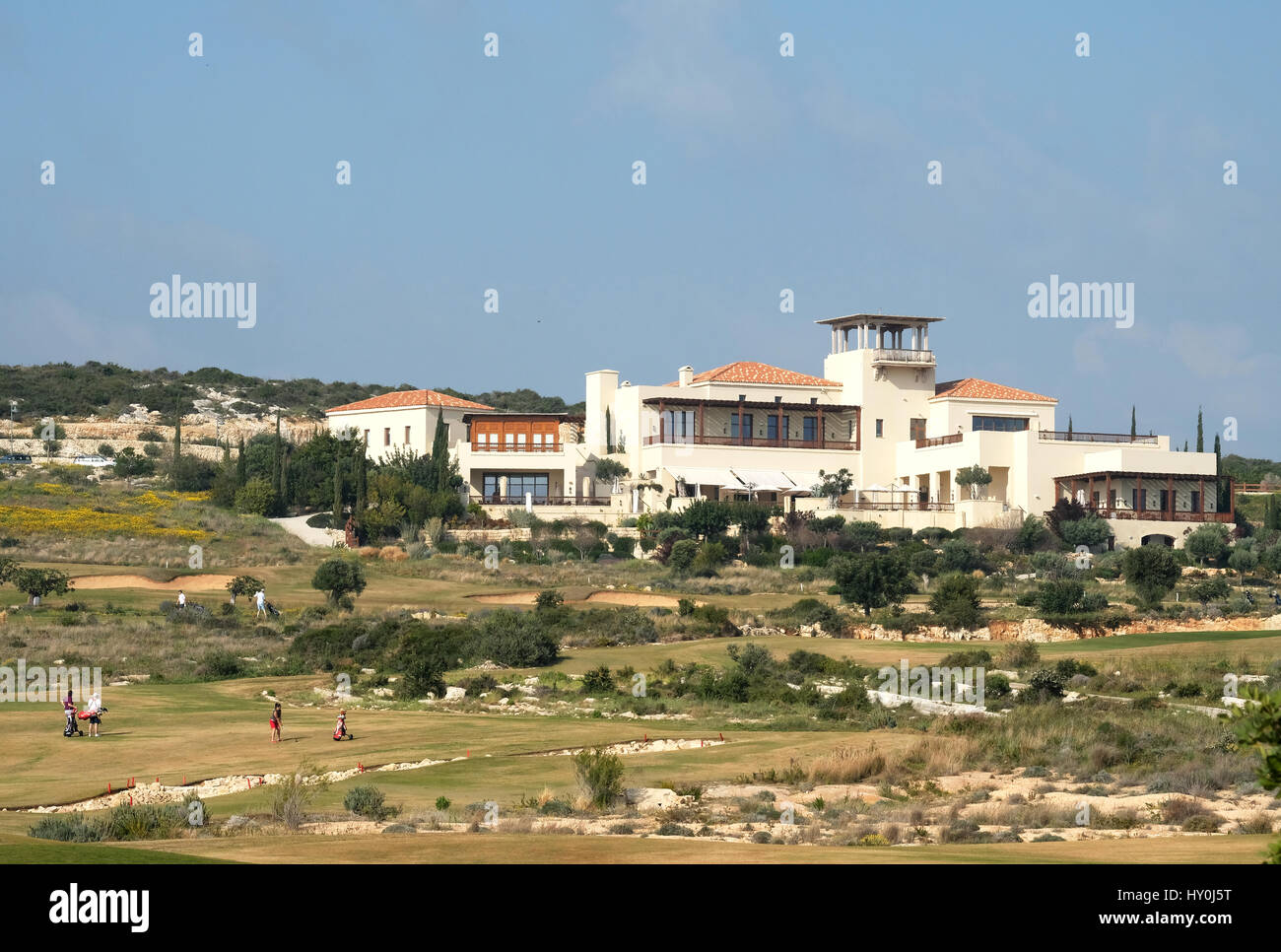 Golfers in the distance playing at the Elea Estates golf course in Paphos Southern Cyprus. - Stock Image