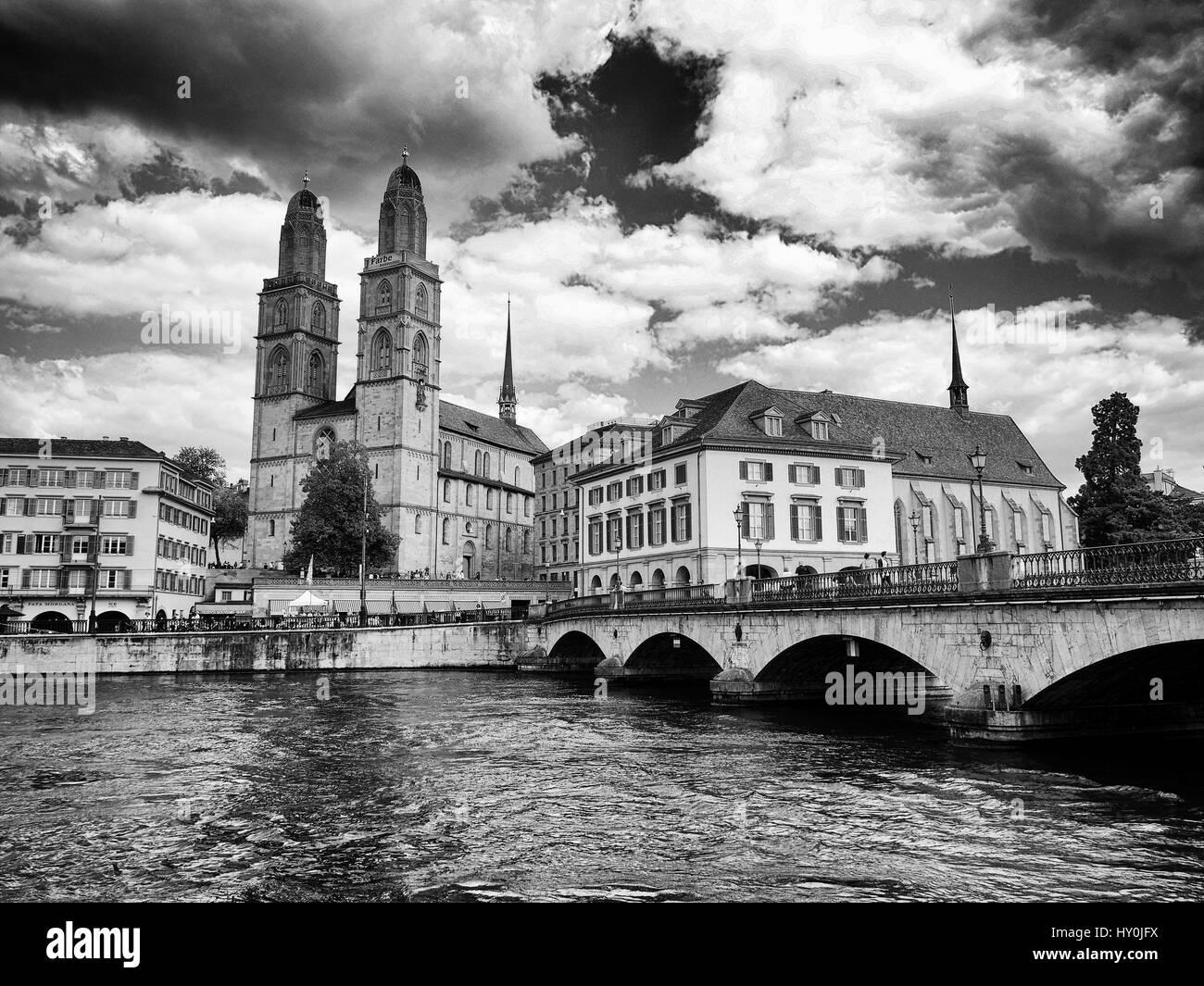 Grossmünster with Helmhaus and Münsterbrücke, Zürich, Switzerland - Stock Image