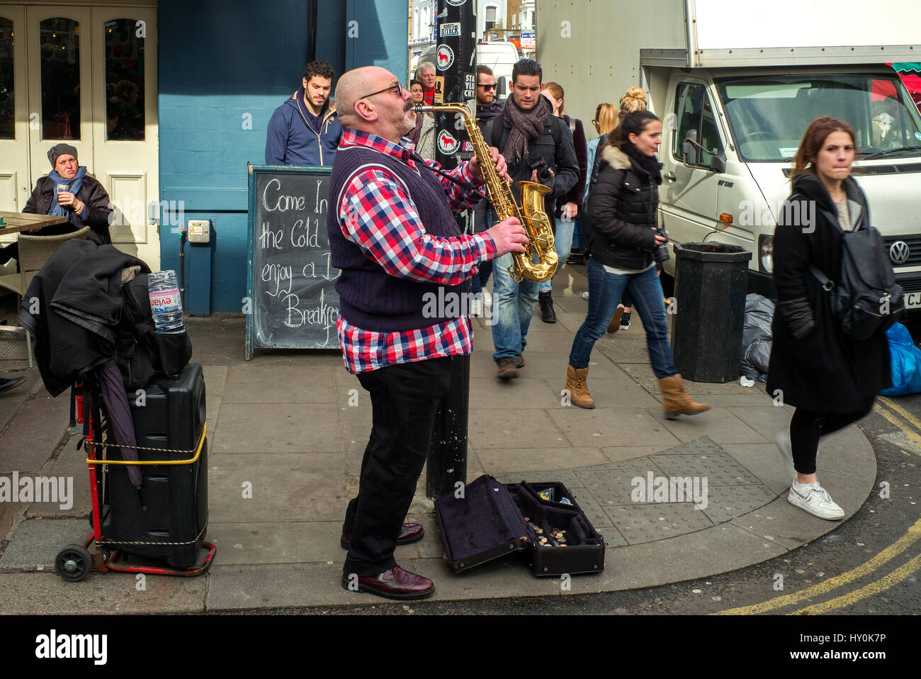 male saxaphone busker ,street busker london , saxophonist playing the saxophone on street corner - Stock Image