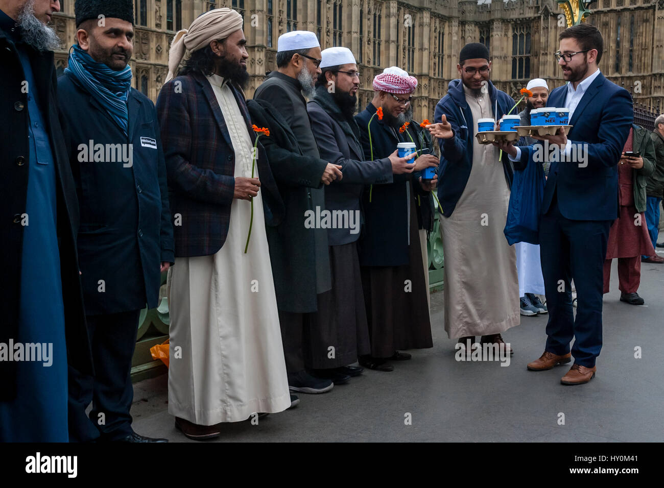 A Man Gives Cups Of Coffee To Some Of London's Muslims Who Had Gathered On Westminster Bridge To Remember The - Stock Image
