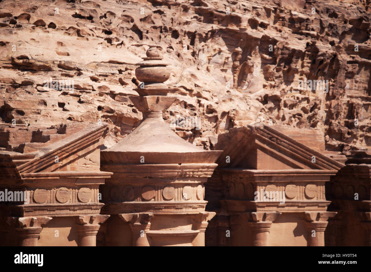 Jordan: the pediment of the Monastery, Ad Deir or El Deir, the monumental building carved out of rock in the archaeological - Stock Image