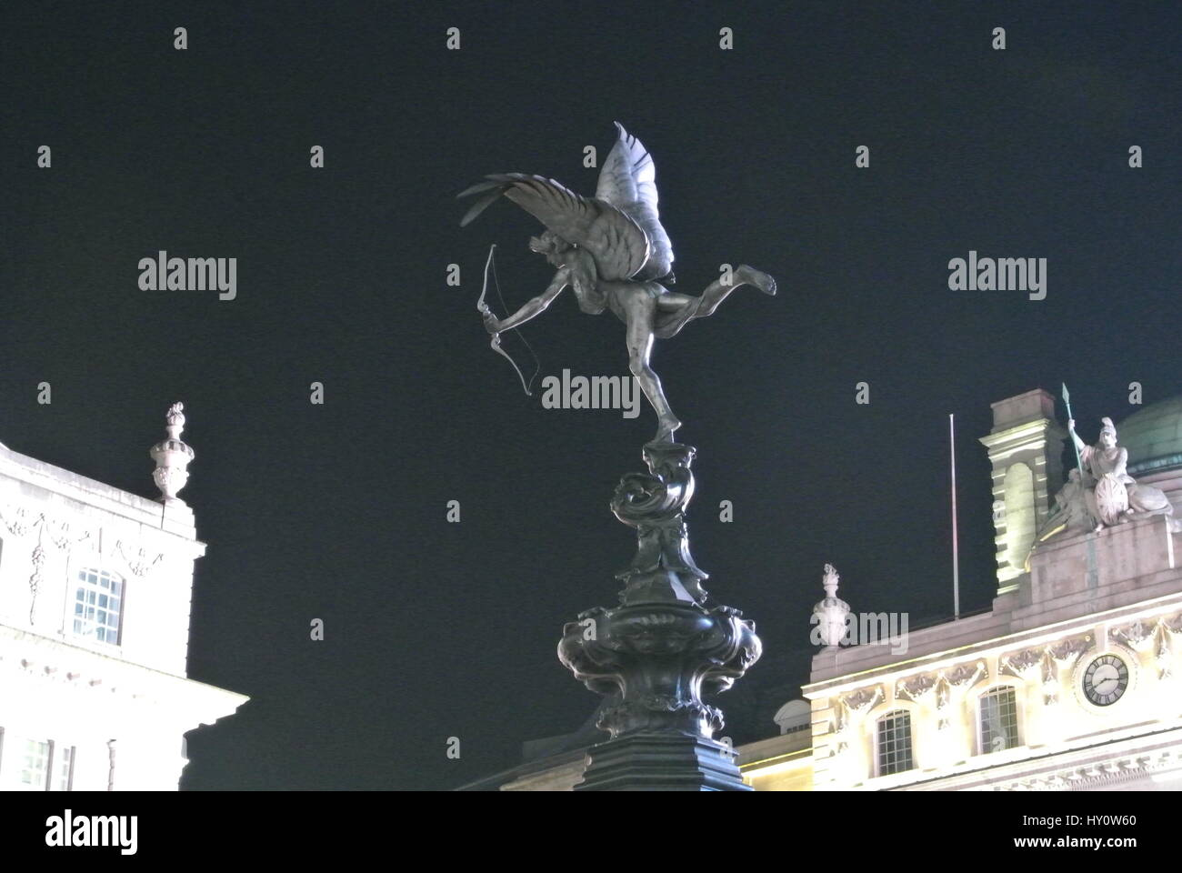 Statue of Eros, on top of Shaftesbury Memorial Fountain,Piccadilly Circus,  London, England - night photo - Stock Image