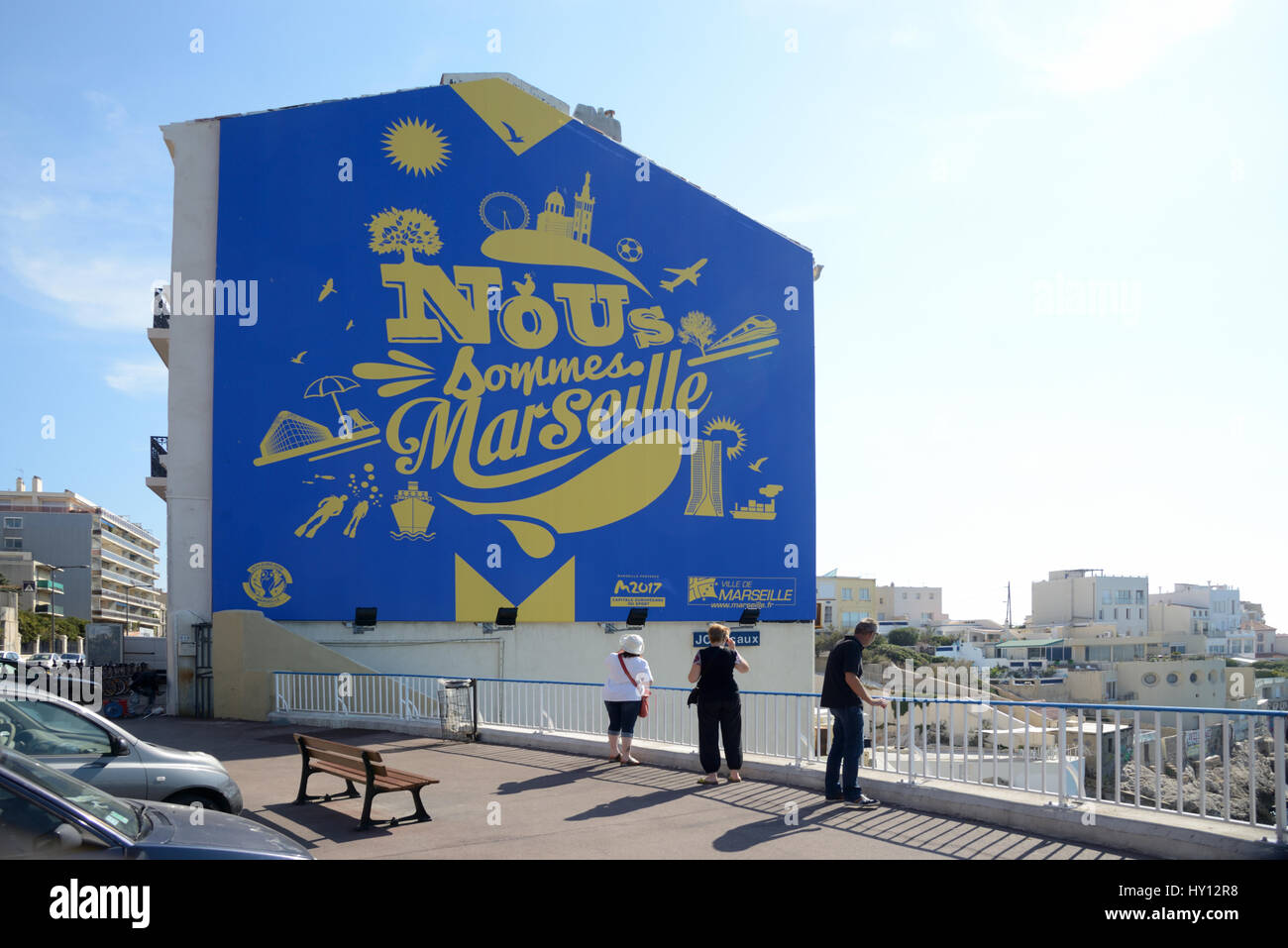 Corniche Road with Wall Painting on the Gable Wall of a House with Iconic Symbols Advertising Marseille France - Stock Image