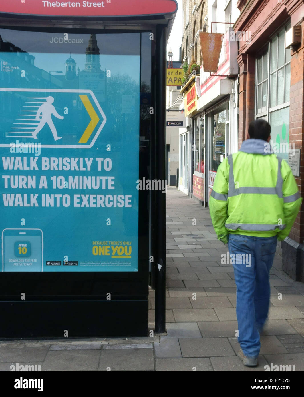 Bus stop poster recommends brisk walking for fitness, London - Stock Image