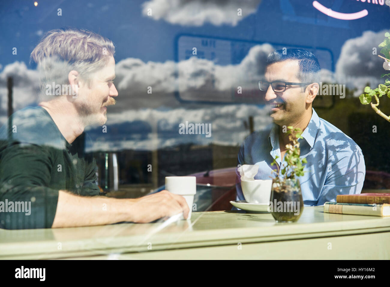 Sweden, Portrait of two mid adult men in cafe Stock Photo