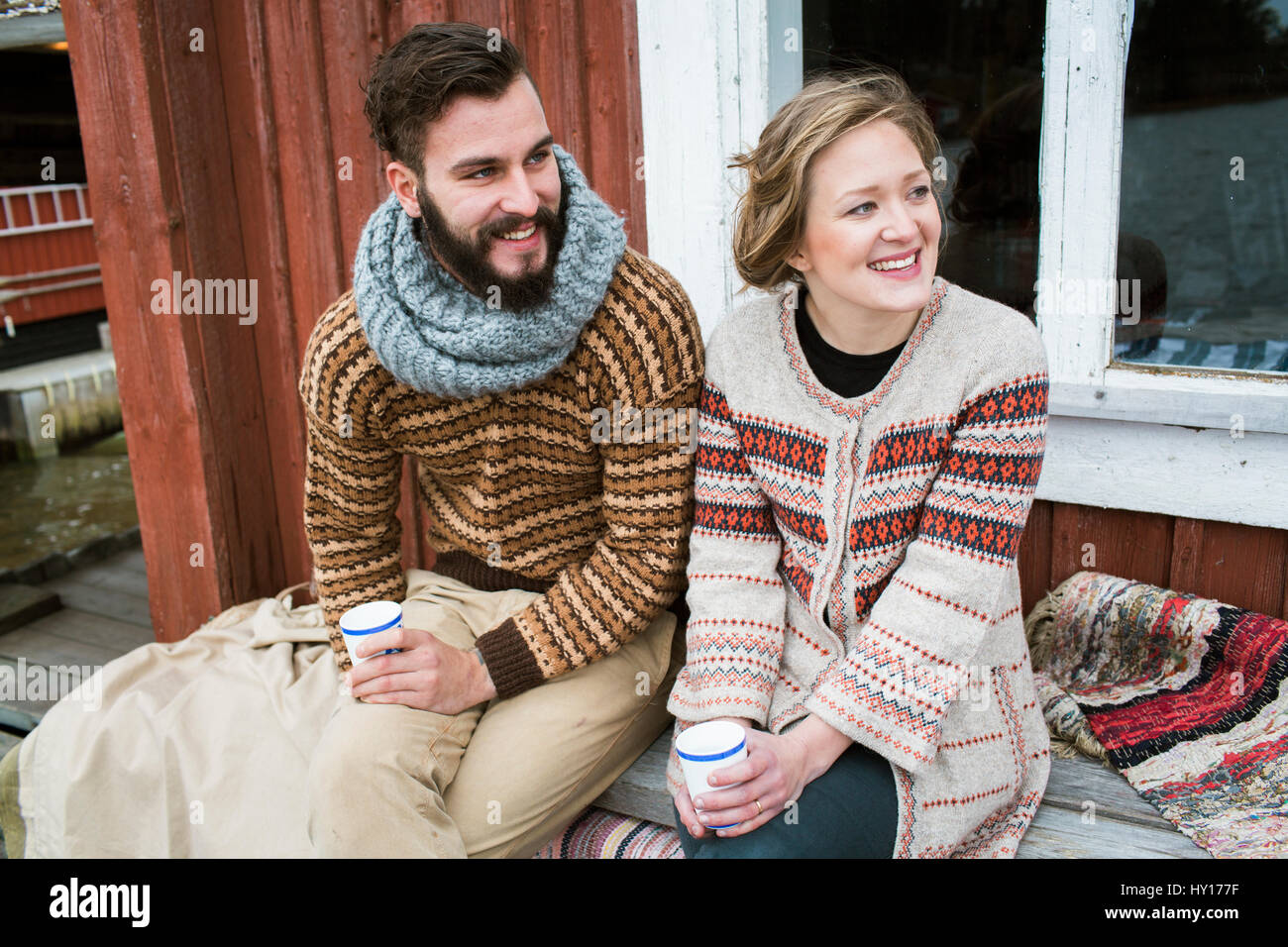 Sweden, Young couple sitting on bench - Stock Image