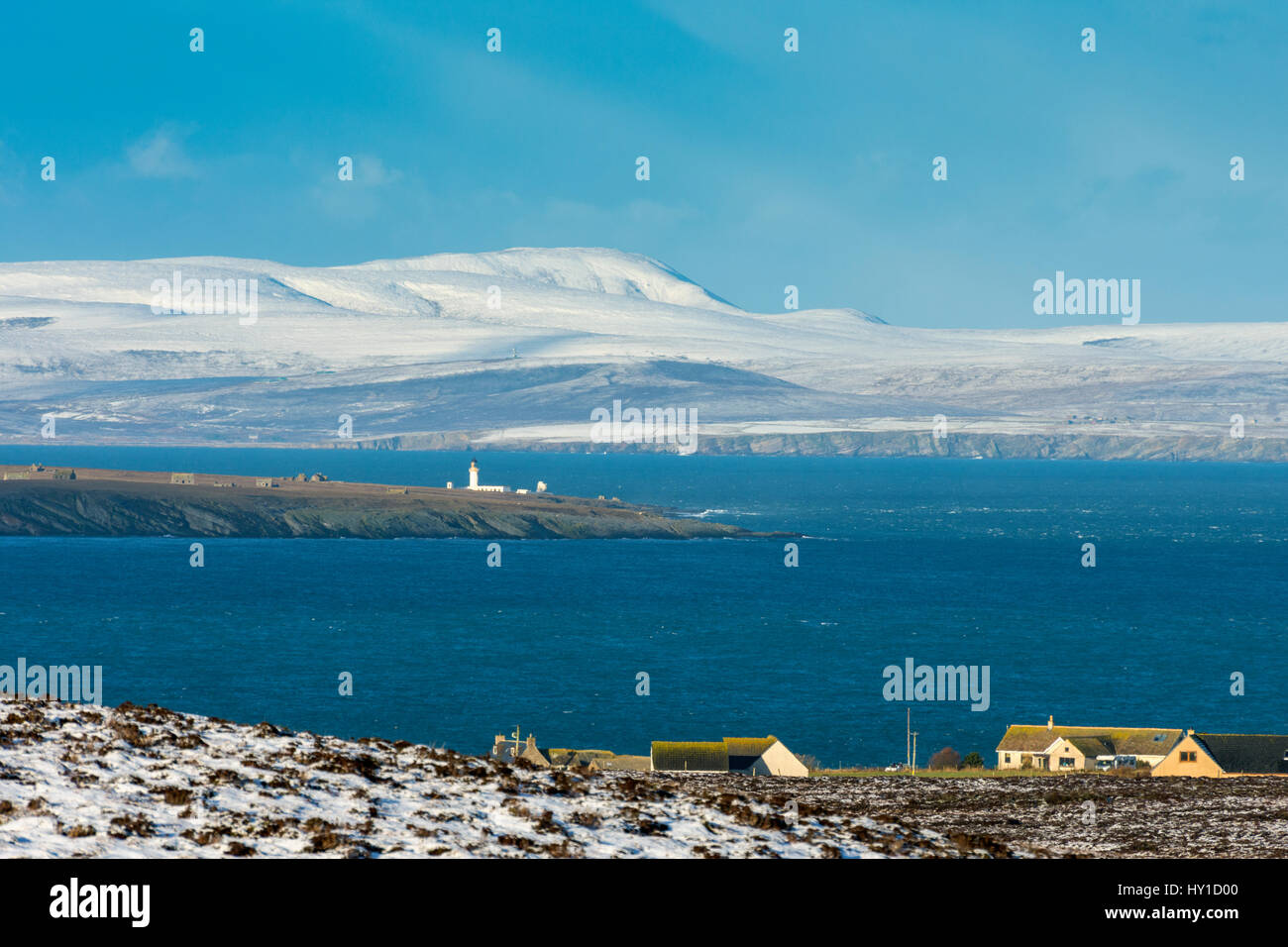 Hoy in the Orkney Isles and the lighthouse on the island of Stroma, from Duncansby Head, near John o' Groats, - Stock Image