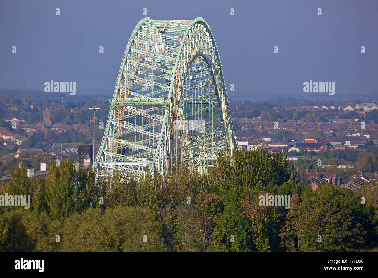 The massive arch of the Queensway bridge across the river Mersey between Runcorn and Widnes in Cheshire. Seen from - Stock Image