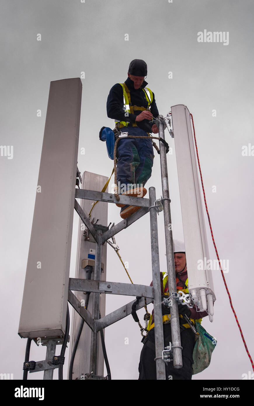 Mobile phone aerials being worked on. - Stock Image