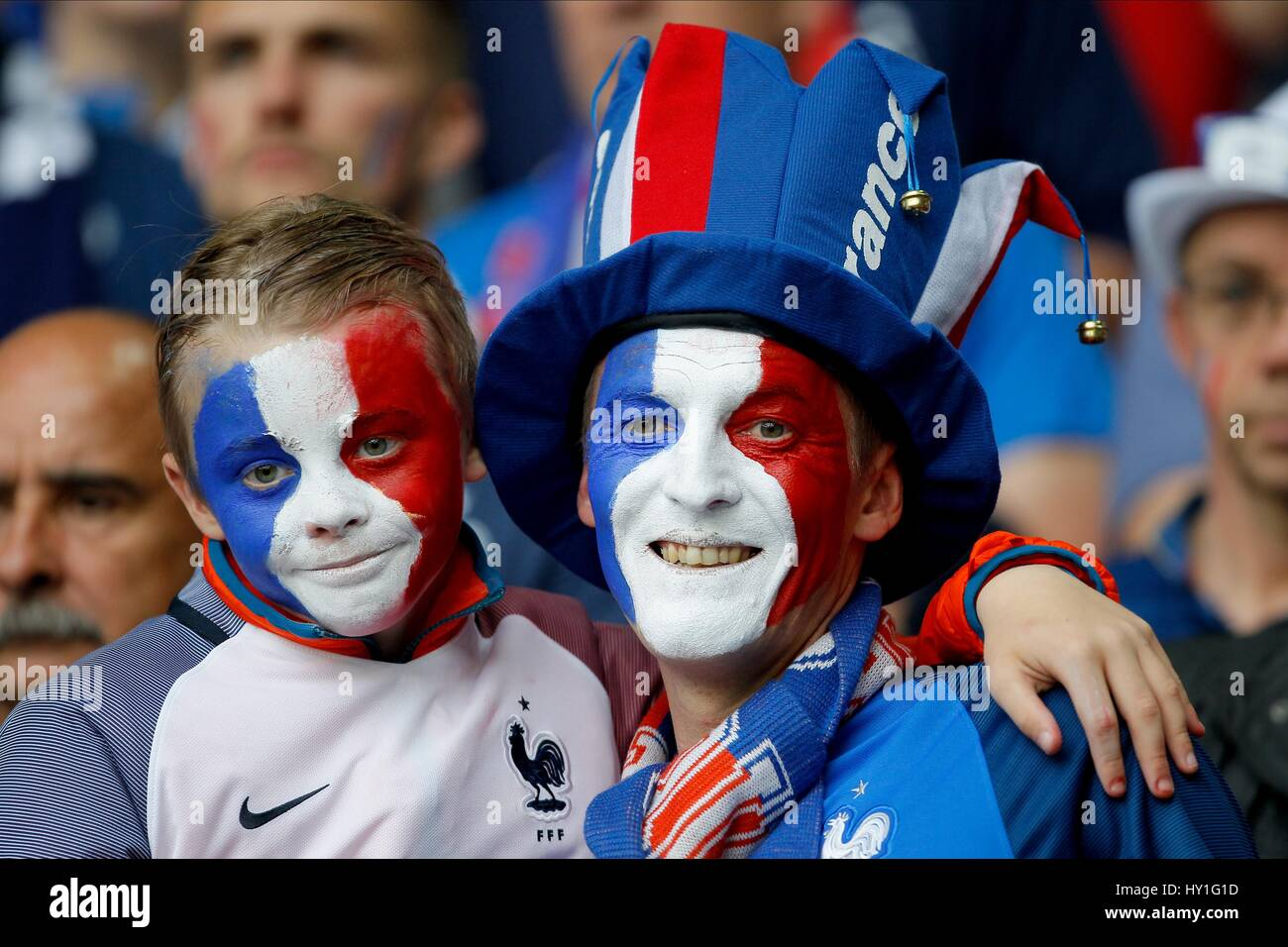 FRENCH FANS WITH PAINTED FACES SWITZERLAND V FRANCE STADE PIERRE-MAUROY LILLE FRANCE 19 June 2016 - Stock Image