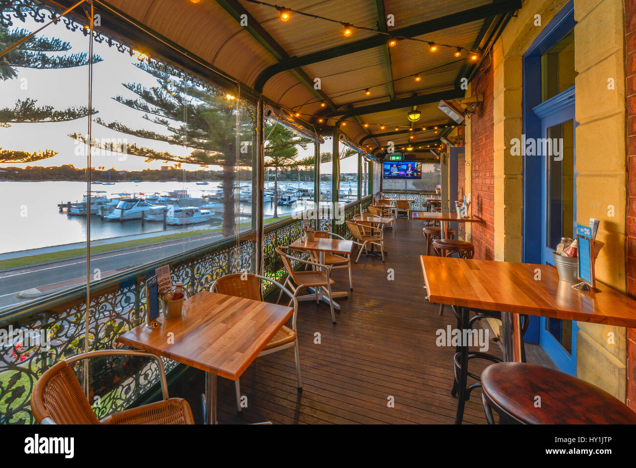 View from the balcony of a typical turn of the century pub, overlooking a marina on the Swan River, Fremantle, Perth, Stock Photo